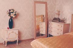 Cozy stylish vintage corner of the ivory bedroom Royalty Free Stock Photos