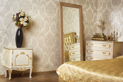 Cozy stylish vintage corner of the ivory bedroom Stock Photo