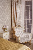 Cozy stylish vintage corner of the ivory bedroom Stock Image