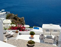 Cozy terrace. With cozy terraces of Santorini offer a view of the sea Stock Image