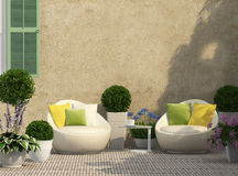Cozy terrace in the garden. With flowers stock photography