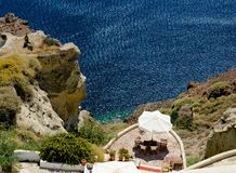 Cozy terrace Santorini. Cozy little terrace was located on a hillside above the sea shore Royalty Free Stock Photo
