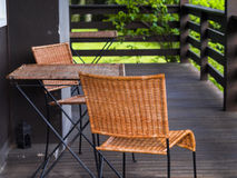 Cozy terrace. Table and wicker chairs to relax on the balcony or terrace of country house Stock Photography