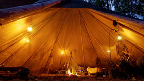 Cozy tipi with oil lamps and camp fire Stock Photos
