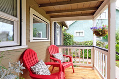 Cozy walkout deck with red chairs Stock Image