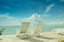 White wooden beach chair with blue sea sky background  Stock Images
