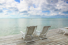 White wooden beach chair with blue sea sky  Stock Image
