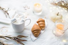 Cozy winter bloggers white work space with laptop, coffee with m royalty free stock photos
