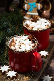 Cozy winter drink hot chocolate on a wooden background, closeup. Vertical stock photo