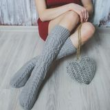 Cozy winter evening , warm woolen socks. Woman relaxing at home. Comfy lifestyle Royalty Free Stock Photos