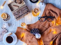 Cozy winter flat lay with home decor and garland lights. royalty free stock photo