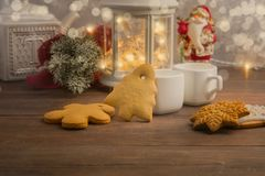 Cozy winter at home with hot drink and cookies. Christmas time with tea and garland. With copy space stock images
