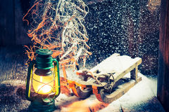 Cozy winter hut with small wooden sleigh Royalty Free Stock Image