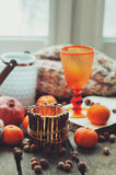 Cozy winter morning at home with fruits, nuts and candles Royalty Free Stock Photos