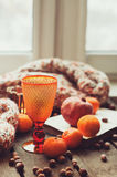 Cozy winter morning at home with fruits, nuts and modern glass, selective focus Royalty Free Stock Image