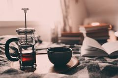 Cozy winter morning at home with hot tea. Having breakfast in bed in real life interior stock images