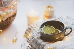 Cozy winter morning at home. Hot tea with lemon, knitted sweaters and modern interior details. Flat lay still life Stock Photo