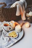 Cozy winter morning at home. Hot tea with lemon, knitted sweaters and modern metallic interior details. Royalty Free Stock Photo