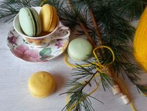 Cozy winter scene with macaroons in soft colors. Macaroons in pretty colors on a white wooden background Stock Photography