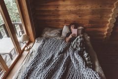 Cozy winter weekend in log cabin stock images