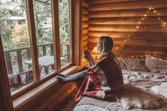 Cozy winter weekend in log cabin stock photography