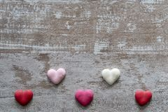 Cozy wooden background, with colorful hearts at the bottom, love concept, for Valentine`s Day, Mother`s Day, Father`s Day,. Christmas, holidays royalty free stock photography