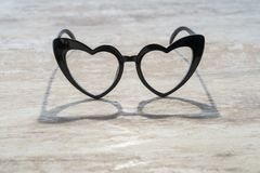 Cozy wooden background, with a heart-shaped glasses that is reflected in the wood, love concept, for Valentine`s Day, Mother`s D. Ay, Father`s Day, Christmas royalty free stock photography