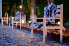 Cozy Wooden Benches in Row on Stone Patio Royalty Free Stock Photos