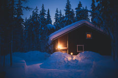 A cozy wooden cottage chalet house near ski resort in winter Stock Photo