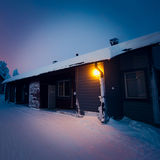 A cozy wooden cottage chalet house near ski resort in winter Stock Images