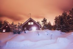 A cozy wooden cottage chalet house near ski resort in winter Royalty Free Stock Photography