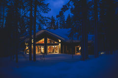 A cozy wooden cottage chalet house near ski resort in winter Royalty Free Stock Photos