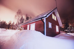 A cozy wooden cottage chalet house near ski resort in winter Stock Photos