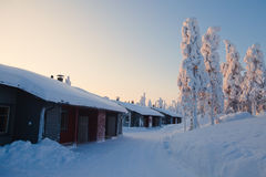 A cozy wooden cottage chalet house near ski resort in winter Royalty Free Stock Image