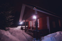 A cozy wooden cottage chalet house near ski resort in winter Stock Image