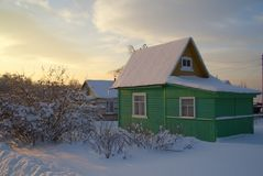 Cozy wooden country house  covered with snow Stock Image