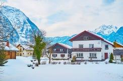 Cozy homes in Alps, Obertraun, Salzkammergut, Austria. The cozy wooden houses in snowy valley among the great Dachstein Alps, Obertraun, Salzkammergut, Austria stock photos