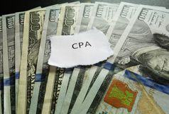 CPA money. CPA paper scrap on money - Certified Public Accountant concept Royalty Free Stock Photos