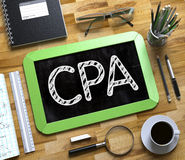 CPA - Text on Small Chalkboard. 3D. CPA - Text on Small Chalkboard.CPA Handwritten on Green Chalkboard. Top View Composition with Small Chalkboard on Working Royalty Free Stock Photos