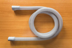 CPAP hose. CPAP air hose on wooden table, use with CPAP machine and mask to help patients with sleep apnea problem Stock Images