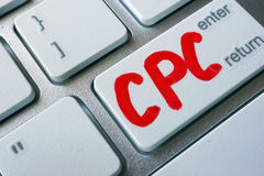CPC cost per click. Word CPC cost per click written on a keyboard royalty free stock image