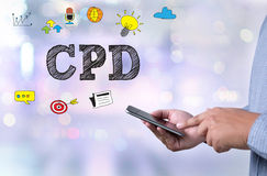 CPD. Person holding a smartphone on blurred cityscape background Stock Photos