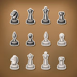 Cpicture of hess 12. Illustration of two color set of chess figures on brown background Royalty Free Stock Photos