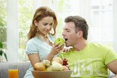 Cpople eating fruits Stock Photos
