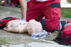 CPR. First aid training. Demonstrating CPR on a dummy Royalty Free Stock Images
