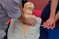 CPR being performed. On a medical-training Stock Images