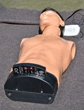 CPR chest compressions dummy for practicing. In summer stock photo