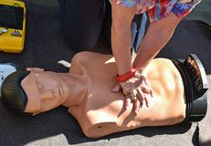 CPR chest compressions practice dummy. In summer royalty free stock photography