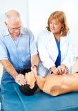 CPR de enseñanza de los primeros auxilios Foto de archivo libre de regalías