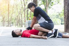 People with a heart attack. CPR with people with a heart attack in park Royalty Free Stock Photos